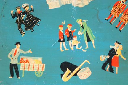 detail of the top of vintage biscuit tin with London illustrations of such as a Pearly king and queen, beefeaters, street hawker etc