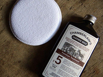 bottle of Chamberlain's Leather Milk No. 5 with applicator pad