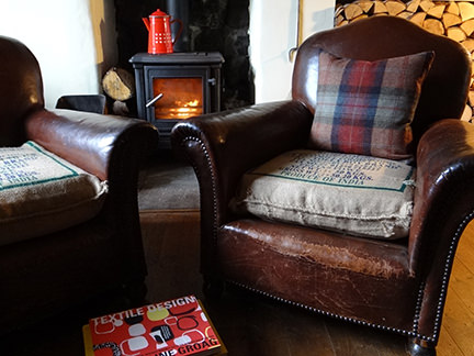 Our pair of vintage leather club chairs in front of the fire