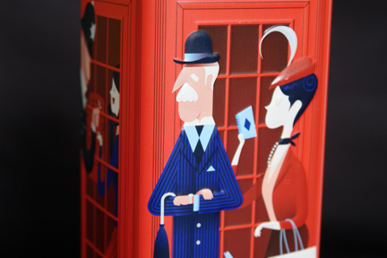 detail from a Marks and Spencer shortbread tin in the shape of and decorated as a red British phone box showing the figure of a city gent