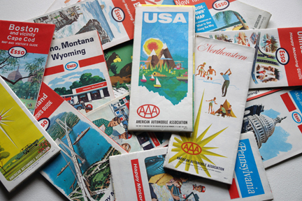 pile of vintage travel maps from the 1960s