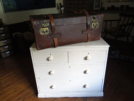 painted antique pine chest of drawers and large vintage leather trunk