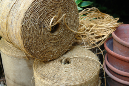 three large reels of jute twine from a selection of vintage garden items