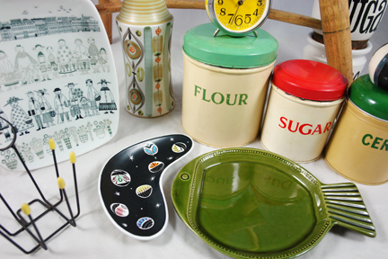 new items at H is for Home, May 2011 including vintage Arabia plate, 1950s aluminium flour, sugar and cereal storage tins, T G Green pottery storage jars and green pottery fish plate