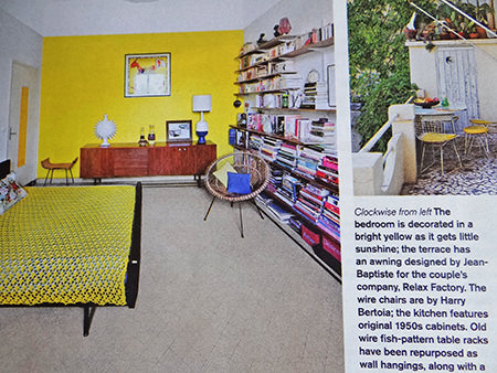 Yellow bedroom in a mid century modern decorated sitting room