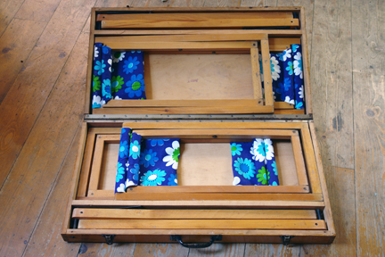 renovated picnic stools put away in their table storage box