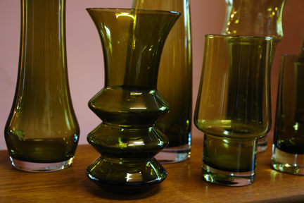 detail of collection of green vintage Riihimaen glass vases