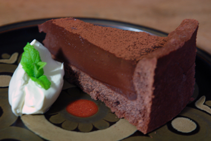 slice of chocolate tart with mocha ganache on a vintage Denby Arabesque plate