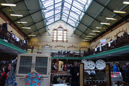 view of 2 floors of stalls at Manchester Vintage Home Show, Victoria Baths
