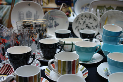 stall selling a collection of vintage pottery mugs