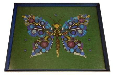 framed & glazed vintage wool work in shades of blue & purple on a green background featuring a butterfly