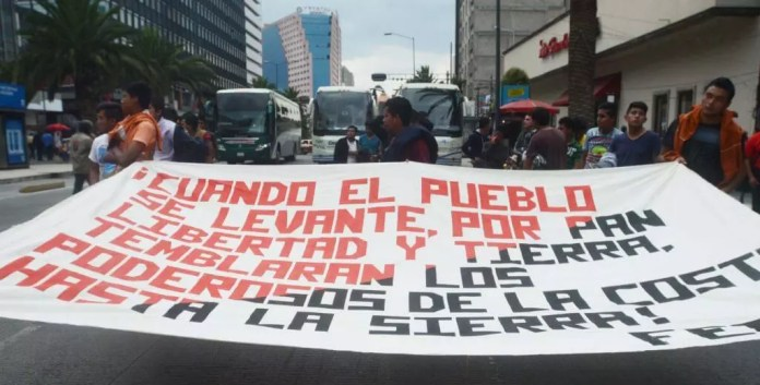 Students from Toluca Mexico hold a banner announcing
