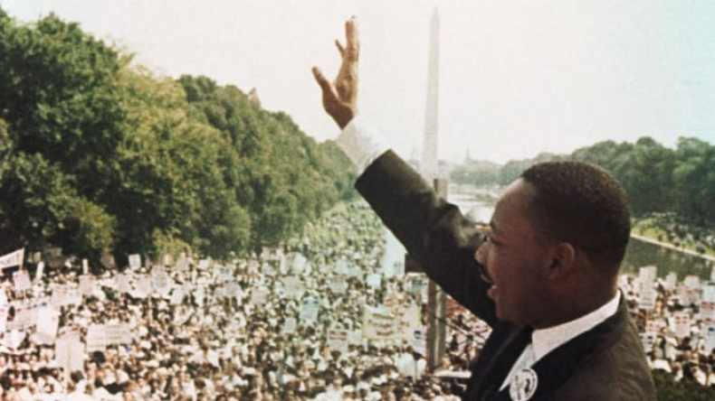 Martin Luther King, Jr. waves to the crowd at the March on Washington, August 28, 1963, where he delivered his famous 'I Have a Dream' speech.