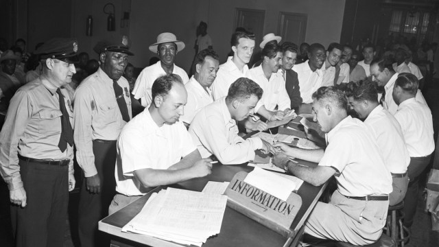 Veterans lining up for a last day rush to get counseling on GI bill educational courses at the New York regional office Veterans Administration on July 25, 1951.