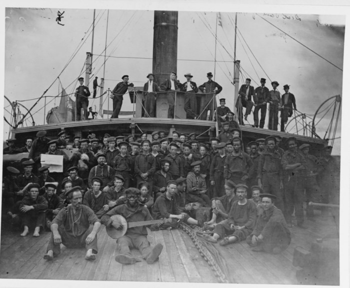 The USS Hunchback's officers and crew on deck in the James River, Virginia, 1864-65.
