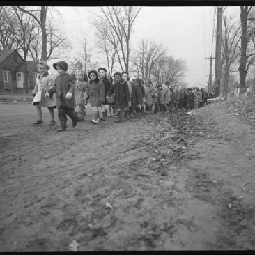 Children walking two-by-two from Woodroffe Public School. November 3, 1955. City of Ottawa Archives, Item CA035144.