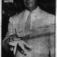 Mayor George Nelms enthusiastically cuts the ribbon to open the new apartment. Source: Ottawa Journal, June 28, 1960, p. 5.