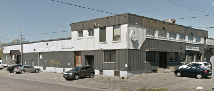 The building in May of 2016. Though functional, there's something a little less special about corrugated steel cladding. Image: Google Maps.