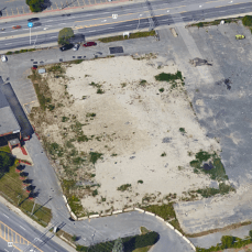 The site today. After a 2010 fire, the station was demolished. Image: Google Maps.