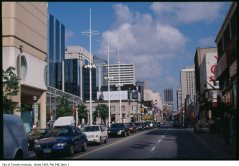 File contains slides that depict perspective drawings of the plans for Dundas square as well as photographs of the area before and after the completion of the project.