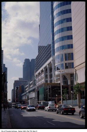 """File consists of slides used in a presentation entitled """"The Toronto Experience"""".;Slides depict Harbourfront, Casa Loma, railway tracks, Yonge street and aerials of the city."""