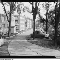 File consists of photographs of the Hoggs Hollow and Yonge Street area. They show mostly houses and apartment buildings in the area, as well as the York Mills Skating Rink and the Jolly Miller bar. There are also a few images of ravine lands and preliminary construction work.