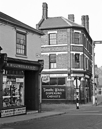The Fold, between Billingsley's tobacconists, and Timothy White's chemists, c.1965 From History Website.