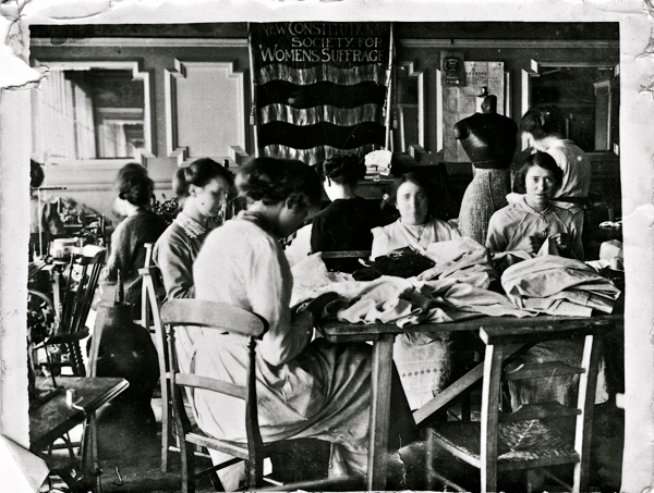 The Work Room set up in 1914 by the NCS as part of its war effort. This is the only image extant of the NCS banner.