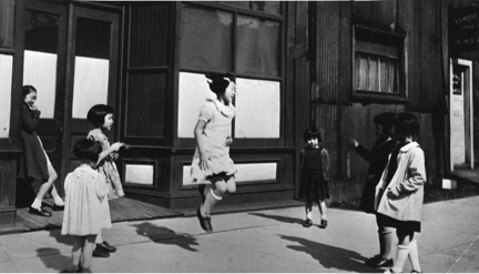 Japanese Canadian girls skipping rope on girls skipping rope on Alexander Street in Vancouver, 1939. Image courtesy of the Nikkei National Museum [2010.23.2.4.236].