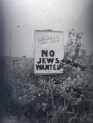 "This sign in Jackson Ontario suggested ""No Jews Wanted"" as the ""slogan of 1938."" Image courtesy of the Ontario Jewish Archives."