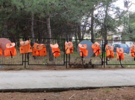 Entrance to Pikpa refugee camp with sign saying 'Safe Passage' on life jackets. Photo courtesy of Bryan Sitch.
