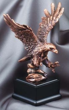"Bronze eagle statue showing the eagle landing, Mounted on black base, RFB011 is 7.5"" tall, Weighs 2 lbs"
