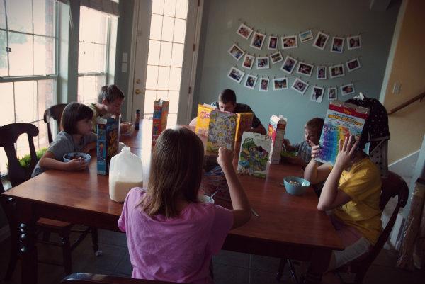 Kids eating cereal