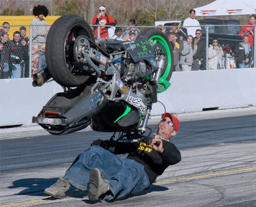 man flipping motorcycle upside down accident