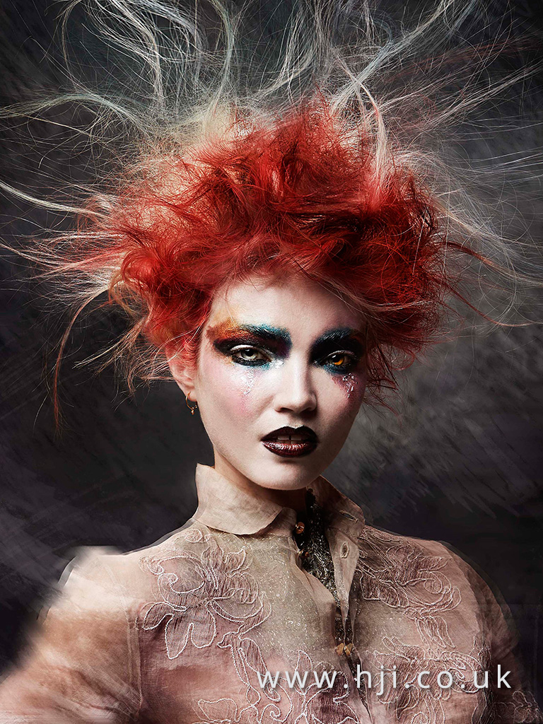 2016 messy redhead avant garde updo hairstyle with stray