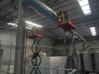 High Level Cleaning - Warehouse and factory cleaning at height in Wigan.