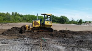 Cutting grade in advance of excavating.