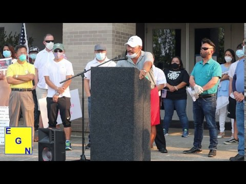 Fong Cha addresses rally protesting racism against the Hmong community