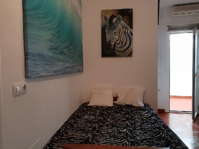 Dormitorio con sofa-cama