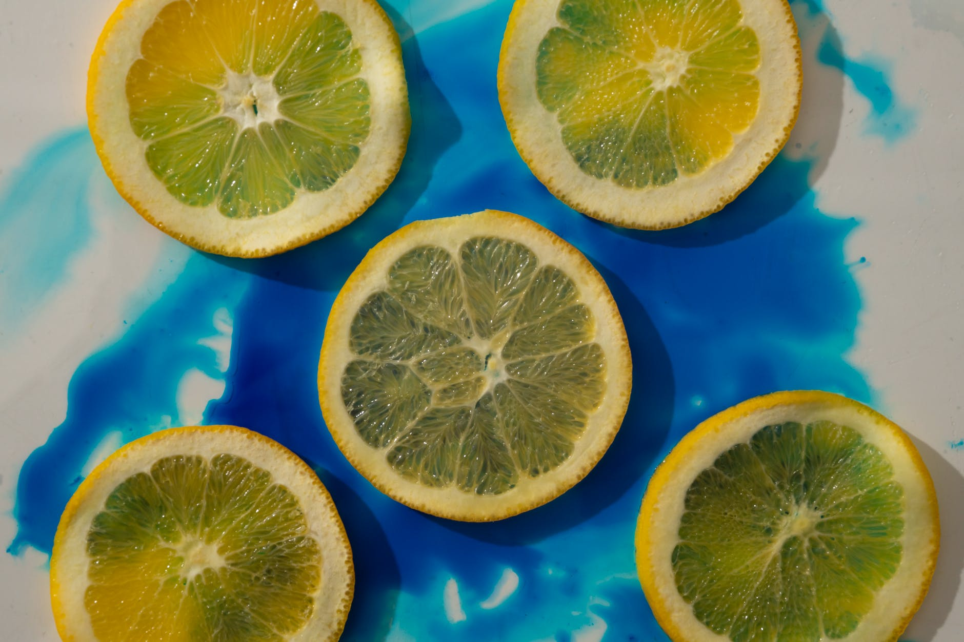 lemon slices on blue and white surface