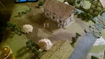The Aussies dig in on the corner of the farmhouse, ready to open up on the advancing patrol
