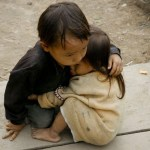 Photo of Two and a Half Year Old Sister Protected by Four-Year-Old Brother in Nepal