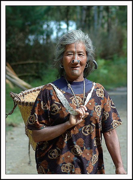 Picture of Apatani Tribe Woman with Nose Plugs and Traditional Basket