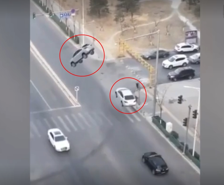 Image about Two Cars Levitated Into Air While On Middle of Busy Road