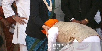 Image about Manmohan Singh Touching Sonia Gandhi's Feet, Photograph