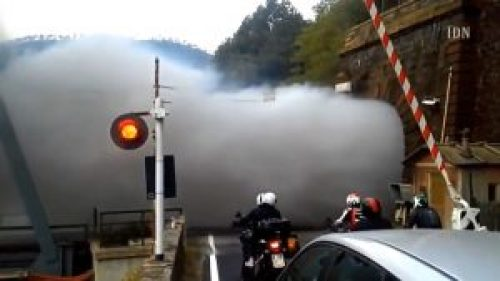 Image of Smoke Cloud coming out of Tunnel after the Steam Train Passes