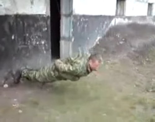 Image about Another soldier performing no hands push ups