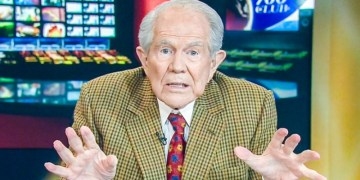 Image about Pat Robertson Claims Jesus Coming Back With AK-47, Camo