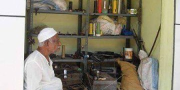 Picture about Abdul Kalam's Brother's Umbrella Repair Shop