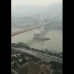 Image from Video of Building Floating Down River in China